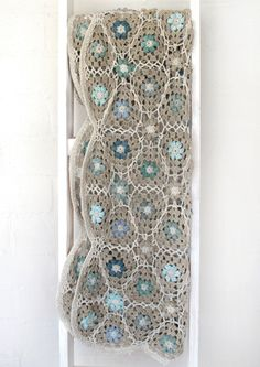 Free crochet PDF pattern for a rustic lily throw blanket.  Soft, delicate flowers with lacy trim and borders.