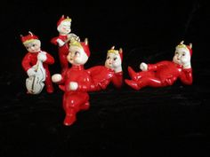 Five (5) Red Devil - Spaghetti Blonde Hair Figurines -Vintage Japan Figurine Set  5 red devils  Two of them that are playing instruments Have broken off music instrument ends. (Could be painted) Im sorry these are hard to find and still cute. One has a funny foot looks like a club foot.Like someone tried to repair but he still stands.  The other 3 just have missing paint and pitch forks.But no chips.  ♥ Smoke/Pet free home If we miss calculate shipping~ you will receive The difference if...