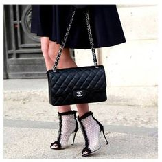 The elegance of classic black Chanel bag. #chanel