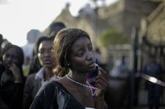 FAREWELL MANDELA 13 December 2013 A woman reacts in disappointment after access to see former South Africa President Nelson Mandela was closed on the third and final days of his casket lying in state, outside Union Buildings in Pretoria, South Africa. photography by MARKUS SCHREIBER