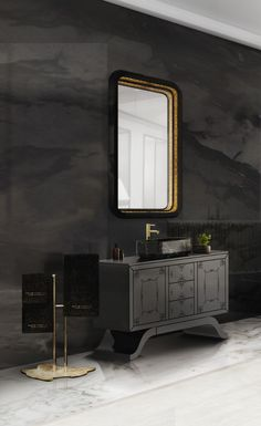 The royal looking Metropolitan washbasin is breathtaking along with the polished brass from the Eden towel rack and the refined carved wood from the Ring rectangular mirror reflect the luxurious style of this bathroom.
