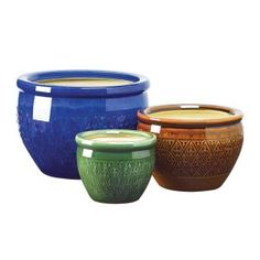 Jewel-tone Flower Pot Trio Bring a burst of color to your garden! Embossed earthenware flower pots are sumptuous in shades of azure topaz and peridot. Jewel-tone Flower Pot Trio by Custom Made.