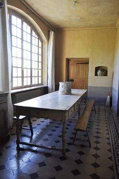 rustic simplicity.  dining room in Provence.  Taken by Katy Elliot.  That floor...