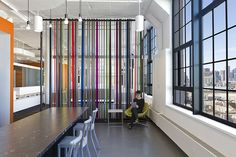 Filzfelt.   CNC-cut strips of 5mm to 8mm Design Felt create colorful space dividers in the Boston headquarters of SatCon Technology Corporation.