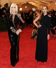 Donatella Versace and daughter wearing Versace couture.