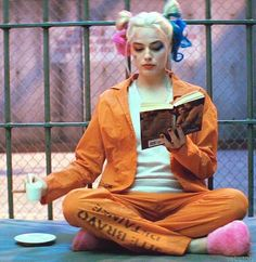 Suicide Squad Harley Quinn in her cell at Belle Reeve Prison drinking espresso, waiting on Mr. J