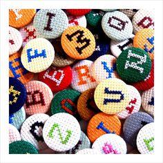 Magasin | Cross-stitch Alphabet button badge    http://www.renegadecraft.com/london-info but as magnets