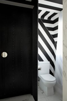 Black And White Graphics Help Define Areas Within This Apartment