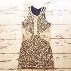 Free People Tank Navy with ivory crochet straps and lace detail. No size but pretty sure an xs. Some wear as pictured. Free People Tops Tank Tops