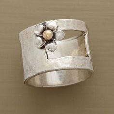 "I love it! A posy centered with 14kt gold blooms outside the window cut into our exclusive sterling silver ring. Handcrafted in whole sizes 5 to 9. 1/2""W."
