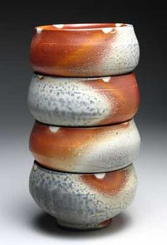 Matthew Hyleck · Stoneware bowls fired to cone 11 in wood/salt/ soda. Wadded on rims. Flashing slip applied (smooth orange or Bauer's?).