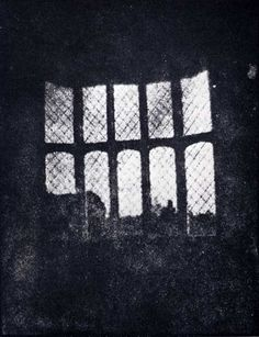 "A photograph of a window at Lacock Abbey, Wiltshire, England. Taken in 1835 by Henry Fox-Talbot. This is a print from the earliest existing photographic negative.   (The earlier Niépce/Daguerre process was based on a ""positive"" image created directly  on to a metal plate)."