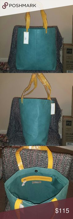 """NWT Taleen Sea Green All Leather Tote Gorgeous sea green tote, unique and stunning. Buttery leather exterior and handles with synthetic material lining the inside. Snap closure. Interior zip pocket plus two extra pockets. Meausrements: 22"""" height, 20"""" length, 8"""" deep, 19"""" shoulder drop. Madewell Bags"""