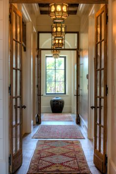 Back Hall with Reclaimed Natural Finish French Doors and Beams  Hallway  Architectural Detail  French Country  Architectural Details  Shingle Style  Eclectic  Coastal  French Provincial  Transitional by Island Architects