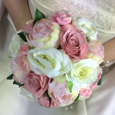 a bridal bouquet of pale pink and ivory silk roses and peony flowers