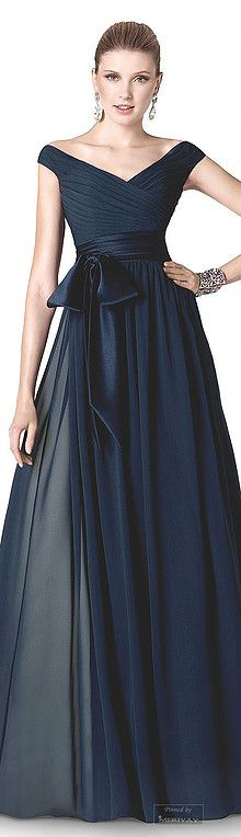 Dark navy blue mother of the bride dresses can be made.  This off the shoulder ball gown has a slight empire waist line. the flowing fabric helps create a great #fashion statement. You can get more info on #motherofthebridedresses (as well as replicas of couture gowns for less) at http://www.dariuscordell.com/featured_item/custom-made-mother-of-the-bride-evening-dresses/