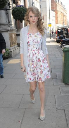Taylor Swift in a flowery dress and grey cardigan
