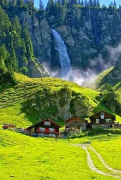 So storybook and picturesque...Klausenpass Switzerland nice green and fresh. Love the cottages and waterfall behind.