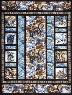 "Alaska's Wild Kingdom quilt is 65""x86"" and features Jody Bergsma's North American Wildlife collection. Kit includes all fabric for quilt top and binding as well as the pattern. (Click to enlarge photo) Retail Price : $110.95"