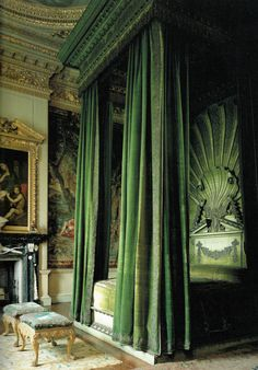 Green velvet bed chamber at Houghton Hall, built in the 1720's for prime minister Sir Robert Walpole. The silver and gold trim are a bit subdued -- tarnished by time. Brussels tapestries behind bed probably ordered for this room and recently restored under the direction of the V & A museum. Prince of Wales slept here in 1797, Duke of Wellington several times.
