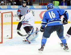 Granlund scores three in Finland's 5-4 shootout win over Switzerland.