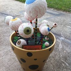 Created by me, Mandi, with dow rods, styrofoam balls, a flower pot and some paint... Love it. A fabulous addition to my all home made Halloween decor....