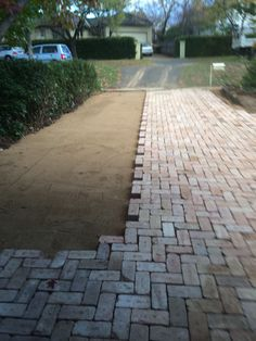 Block paving in progress using Canberra red bricks.
