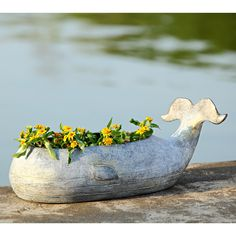 <p> This stylish Whale Planter Set of 2 is made of aluminum and is the perfect outdoor patio, pool side or entryway accent for your coastal beach home.<br /> <br /> Select bright colored flowering plants to fill this unique pair of whale planters for that