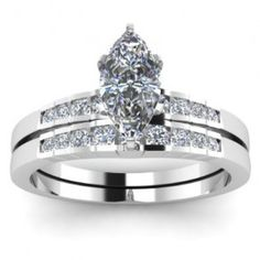Marquise Cut Diamond Engagement Ring Wedding Set - A classy combination describes the duo with this 14k White Gold Marquise Cut Diamond Engagement Ring Wedding Set placed in a channel setting that features a White Marquise cut center stone with 17 White Round cut accent stones around the shank & band. This Marquise Cut engagement set comes with an SI1 in clarity as well as an E in color. The total gem weight is equal to .75 carats. All of the diamonds are 100% natural…
