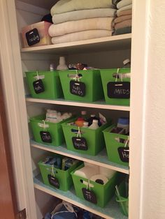 Linen closet organization. Baskets from the Dollar store and  black board tags from Target $1-$3 section