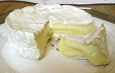 """Camembert-a soft, creamy, surface-ripened cow's milk cheese. It was first made in the late 18th century in Normandy in northern France. AOC """"Camembert de Normandie"""" legally has to be unpasteurised, which is the traditional method. Aged atleast 3 weeks, the ripening process produces the distinctive rind and creamy interior texture characteristic of the cheese."""