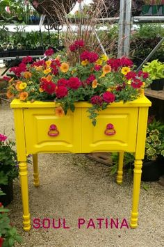 Yellow planter made from sewing cabinet. General Finishes milk paint. Done by Soul Patina.