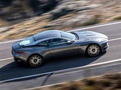 The worst-kept automotive secret of the year, Aston Martin's long-awaited has been officially revealed at the Geneva Motor Show. Our first glimpse of Aston's 'Second Century' plan, it's the illustrious company's most significant car since the arrived in Aston Martin Lagonda, Aston Martin Sports Car, Aston Martin Db11, Gq, Automobile, Cars Uk, Geneva Motor Show, Twin Turbo, Sport Cars