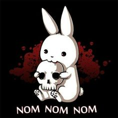 Hungry dark bunny eating a skull