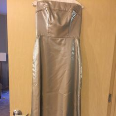 Tan, iridescent strapless Bridesmaid dress. 2 available - sizes 10 and 12 in bridesmaid dress sizes - Fits more a size 6 and 8. MOVING SALE! Name your price in comments section. Dresses Strapless