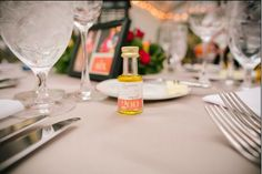 Gorgeous wedding table!! Mini Las Doscientas olive oil bottle for individual use or as a wedding favor.