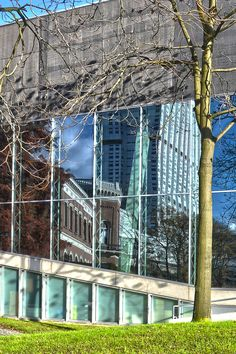 Erasmus Medical Center and Nature Museum reflecting in the glass facade of the Kunsthal auditorium, Rotterdam, Holland