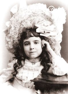 Great picture of little Victorian girl.  And what a big hat she has on!
