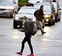Pedestrians cross a street Wednesday in the South Lake Union neighborhood of Seattle. A study for the journal Injury Prevention had observers watch 1,102 Seattle pedestrians at 20 intersections to see how many were using mobile devices.