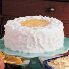 Pineapple Layer Cake...Really enjoyed the fresh taste of this cake. I used fresh pineapple. Wish I had doubled the amount. Critics said it could have used more on the inside.