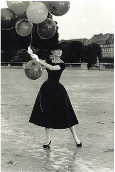 Audrey Hepburn wearing black short sleeved dress and ballet shoes