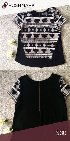 Anthropologie printed top A bit of a heavier material, with a embroidered front and back zipper. Anthropologie Tops Tees - Short Sleeve