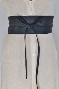 Taking inspiration from the Orient, the obi-styled belt doesn't just cinch the waist, but it adds a unique perspective to whatever you're wearing. Wrap and tie in front, or change it up and tie on the
