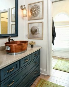 love the raised copper sink, light fixture and the navy blue cabinetry!