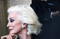 Carmen Dell'Oreficea.  I see her photo, and she is very stunning; but not knowing her, this shot seems to speak a little about her; the line of the nose, the sharp chin, the angle of the jaw, the heavy eye make up, the hair pulled away and not so dominate.   ak