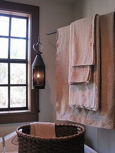 use old fabrics, lightly walnut stained, along with a lg basket!!