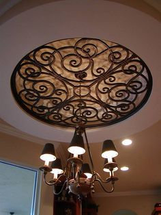Faux Wrought Iron Ceiling Medallion Over Chandelier.