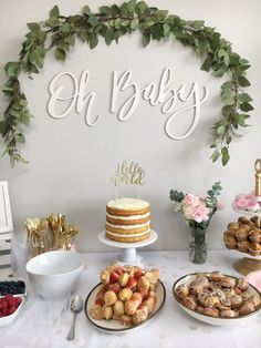 Love the arch of greenery for this baby shower idea! Dessert table is earthy, simple, and elegant...Oh Baby!
