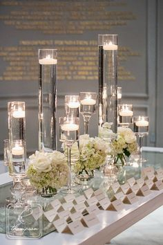 Floating unscented candles are a another simple method combine our services and bring a designer's come in contact to cutlery, focal points and bud vases. Just apply plants, mirrors hyperlinks or dyed water. Wedding Table Centerpieces, Reception Decorations, Event Decor, Quinceanera Centerpieces, Graduation Centerpiece, Card Table Wedding, Simple Centerpieces, Centrepieces, Wedding Seating