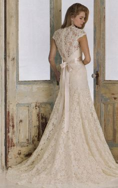 love the lace, the tiny buttons down the back (even the awesome doors in the background)